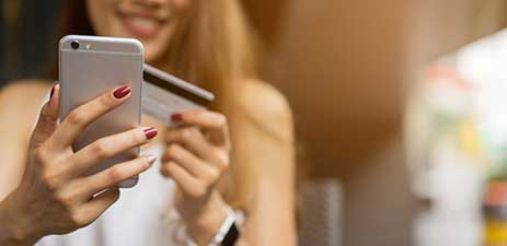woman making online purchase on mobile phone